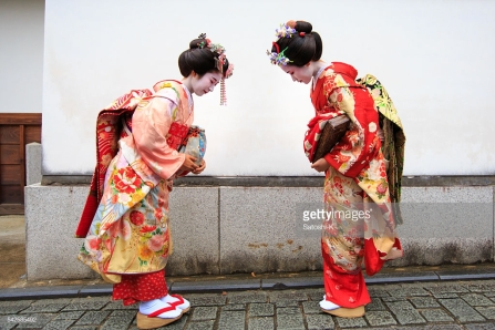 Japanese Maiko girls bowing each other